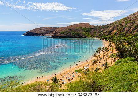 Paradisial Beach With Unrecognizable People At Hanauma Bay, Oahu, Hawaii