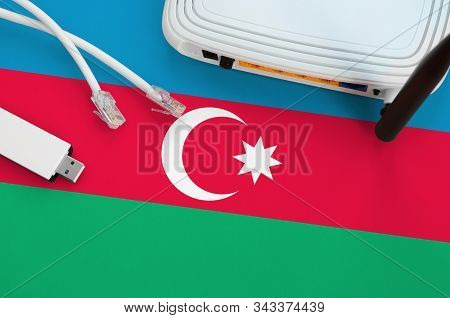 Azerbaijan Flag Depicted On Table With Internet Rj45 Cable, Wireless Usb Wifi Adapter And Router. In