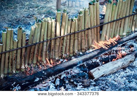 Burning  Khao Lam , Glutinous Rice Roasted In Bamboo Joints Or Khao Lam Is Thai Dessert.