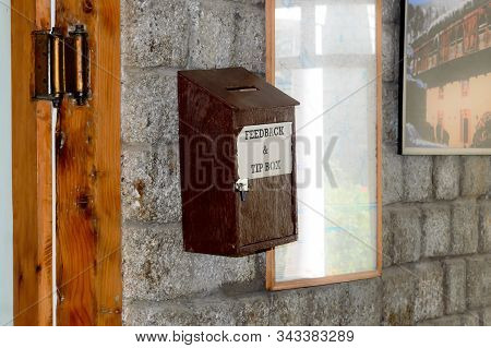 Wooden Suggestion Or Complaint Box Or Letter Box Mounting On Doorway Wall Of A Tourist Resort Hotel