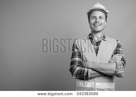 Handsome Man Construction Worker Against Gray Background