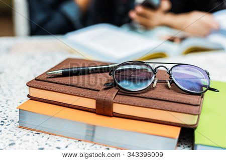 Glasses And Pen On The Book At Shool.