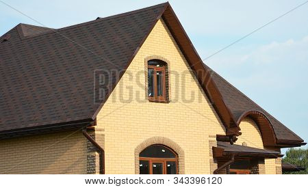 Asphalt Shingles Rooftop. Roofing Construction Rooftop House Building With Asphalt Shingles, Rain Gu