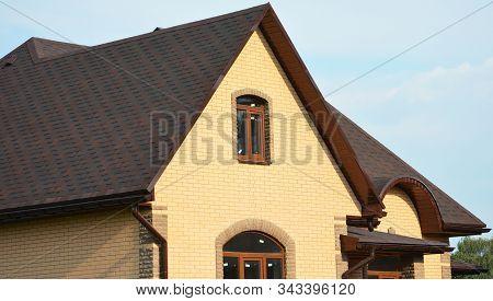 Asphalt Shingles Rooftop. Roofing Construction Rooftop House Building With Asphalt Shingles, Rain Gu