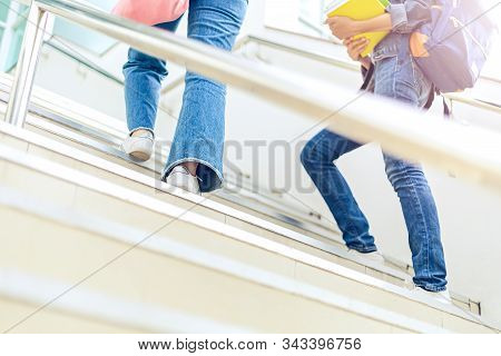 College Student Walking Up The Staircase In University.