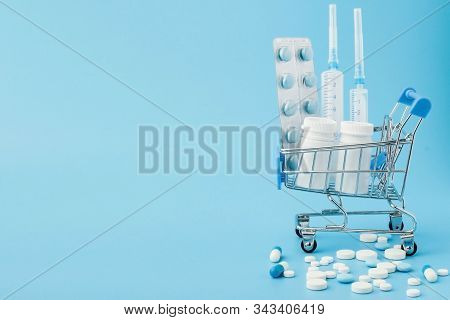 Pharmacy Medicine. Shopping Cart With Pills And Medical Supplies.