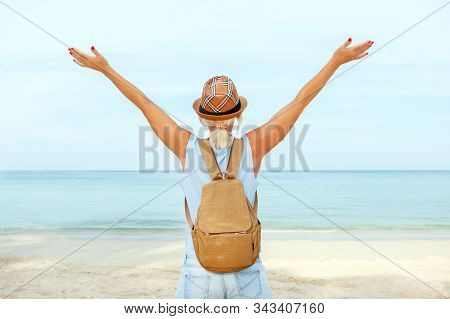Happy Woman Enjoying At The Beach. Happy Adult Woman Enjoying Freedom With Open Hands On Sea.