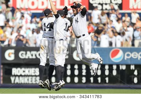 BRONX, NY-JUN 26: (L-R) New York Yankees outfielders Curtis Granderson (14), Brett Gardner (11) and Nick Swisher (33) celebrate after a win against the Colorado Rockies on June 26, 2011 in New York.
