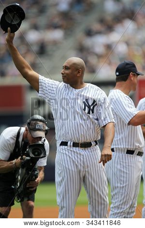 BRONX, NY - JUN 26: Former New York Yankees outfielder Bernie Williams tips his cap to the crowd during the Yankees Old Timer's Day pregame ceremonies on June 26, 2011 at Yankee Stadium.