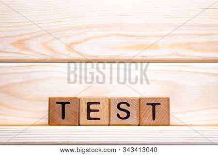 Test Word Made Of Wood Background. Test Sign, Exam, Learning Concept. Word Test Written With Wooden