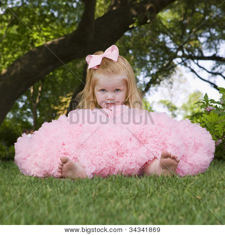 Little girl Sitting Outside Wearing Tutu
