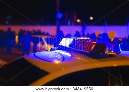 Police Lights. Blue Flasher On The Police Car At Night. Police Units Respond To The Scene Of A Stree