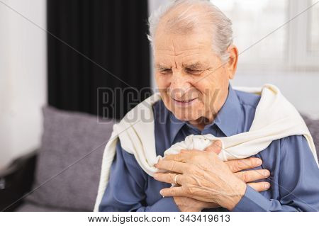 Senior Man Have A Heart Attack. Senior Man Is Having Pain In His Chest.heart Attack Symptoms