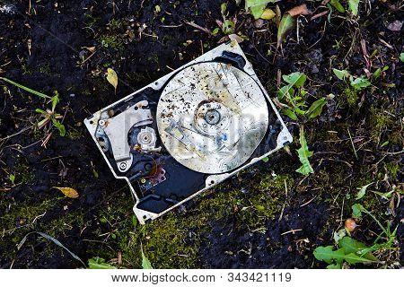 Crushed Hard Disk Drive On The Dirty Ground Closeup
