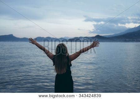 Happy Girl Rejoices Summer. Beautiful, Scenic Sea Landscape. Young Child Playing Outside. Summertime