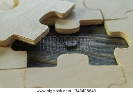 Close-up On Unpainted Plywood Puzzles With One Piece Taken Out, Showing Wooden Surface Underneath, P