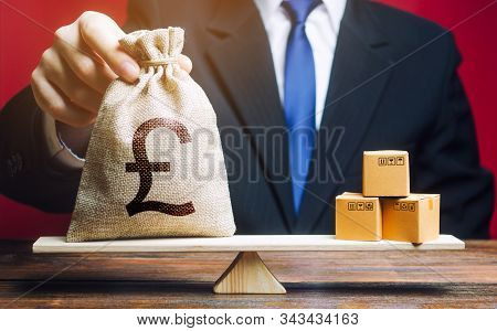 Pound Sterling Gbp Symbol Money Bag And A Bunch Of Boxes On Scales. Trade Exchange Balance. Import A