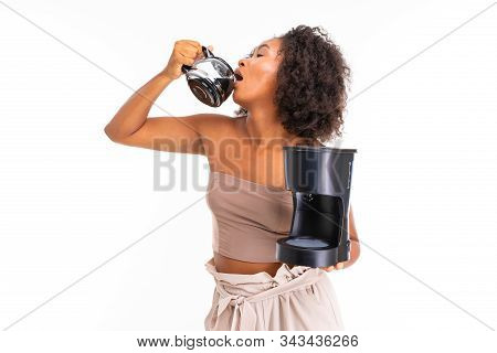American Girl Drinks Coffee And Holds A Coffee Machine On A White Background.