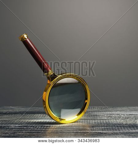 Magnifying Glass On A Gray Background. Search And Analysis, Analytics And Study. Find Something. Jou