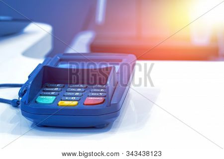 Payment Terminal On Table In Restaurant. Financial Concept.