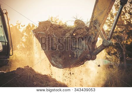 Excavator Is Working During Sunset, Construction Site Digger,loader Backhoe