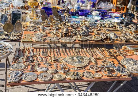Bronze And Metal Objects Sold On A Street Flee Market In Athens