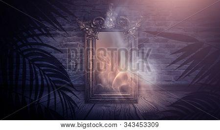 Dark Night Magic Scene. Magic Old Mirror In A Metal Frame On A Wooden Tabletop. Smoke, Magic, Magica