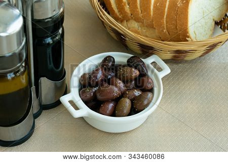 White Keramic Bowl Full Of Fresh Prepared Olives With Olive Oil And Bread.large, Dark Purple Olives