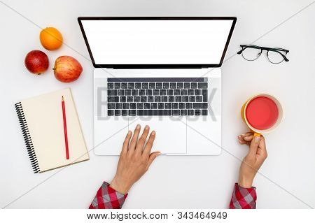 Top View Of Beautiful Woman 's Hands Using Laptop