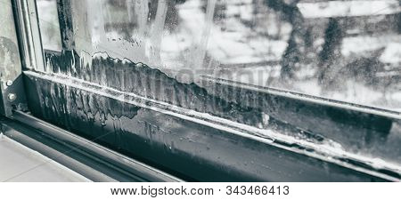 Window humidity condensation in home interior during cold winter weather panoramic background. House problem.
