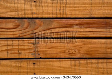 Close Up Of This Horizontal Fence Puts Emphasis On The Rich Colours Of The Wood And The Blemishes Fo