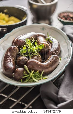 Roasted Sausages In Pan With Rosemary. Traditional European Food Bratwurst Jaternice Or Jitrnice.