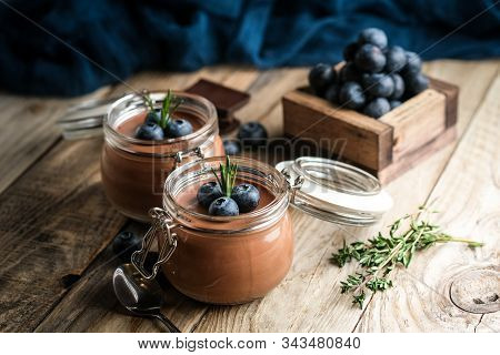 Chocolate Mousse In Glass Jar With Berries On A Dark Background Copy Space. Homemade Dessert.