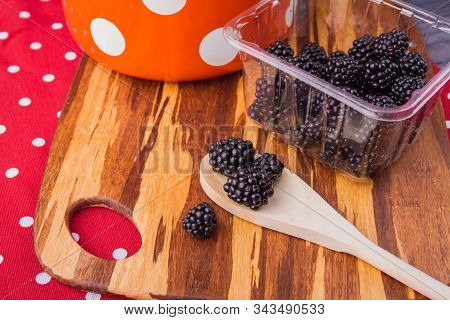 Fresh Raw Blackberries Prepared For Cooking Jam. Wooden Tablespoon And Berries Harvest On Wooden Boa