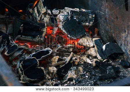 Smoldering Embers From A Fire. Extinguishing Bonfire. The Texture Of The Embers Closeup. Decrepit Ch