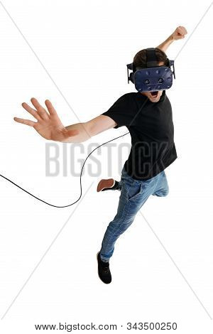 Screeming Young Man Isolated On White Background Playing Game In Virtual Reality Glasses. Virtual Re