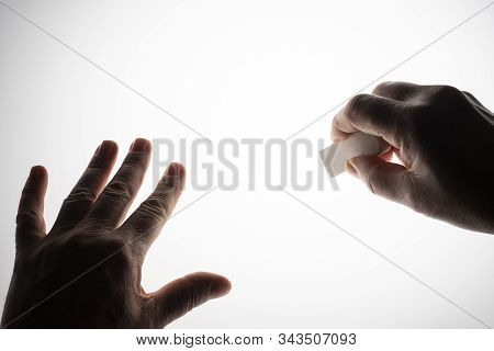 The Gesture Of Erasing With An Eraser On A Backlit Surface