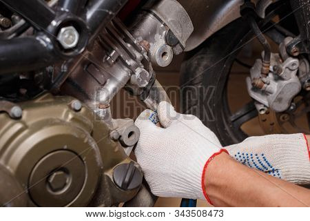 The Process Of Removing The Exhaust System From Replacing Brake Pads On A Motorcycle.