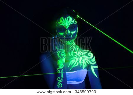 Body Art On The Body And Hand Of A Girl Glowing In The Ultraviolet Light.