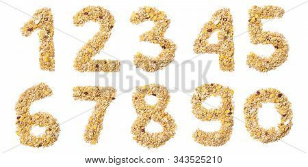 Arabic Numerals   From Muesli With Coconut, Berries, Raisins, Cereal And Natural Cereals  On A White