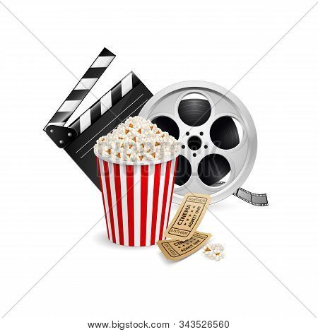 Movie Clapper Board, Cinema Ticket, Popcorn In The Striped Bag And Film Reel Over White Background.
