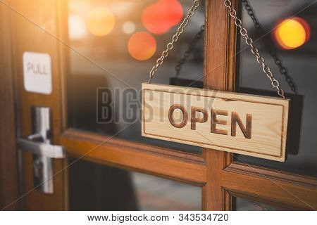 Open Sign Broad Hanging On Wood Door Front Of Cafe. Business Service And Food Concept. Vintage Tone