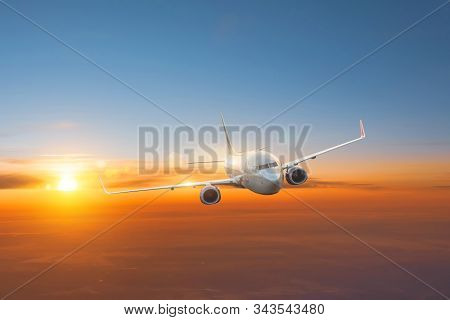 Plane Flies At Dawn High In The Sky