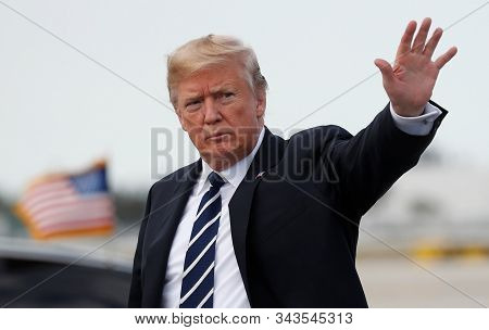 Florida,united States,december 2019,united States President Donald Trump Waves His Hand When He Arri