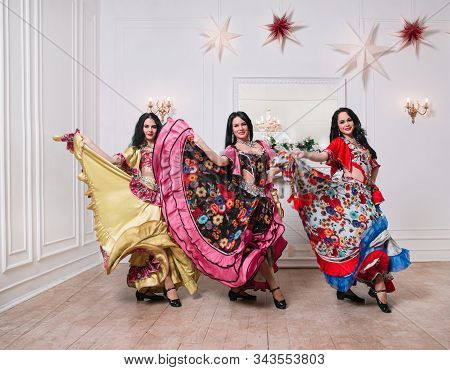 Three Attractive Female Dancers Performing A Gypsy Dance
