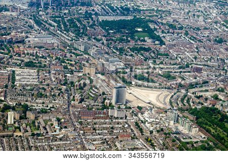 Aerial View Looking North Across Earls Court And Holland Park Districts Of Central London On A Sunny
