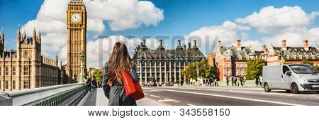 London city commuters walking by Westminster Big Ben people lifestyle. Tourist woman commuting in the morning banner panorama.