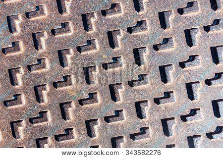 A Metal Manhole Cover On Spanish Urbanisation