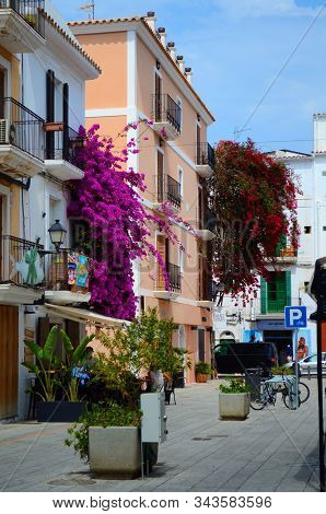 Ibiza Town. Ibiza.spain - 28 May 2019. Beautiful Street And Colorful Bougainvillea In The Old Town O