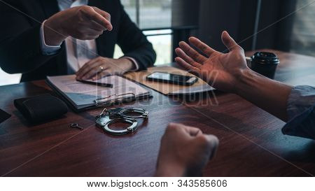 Police Officer Presenting Evidence To Suspect After Committed A Crime, Investigation And Interrogati